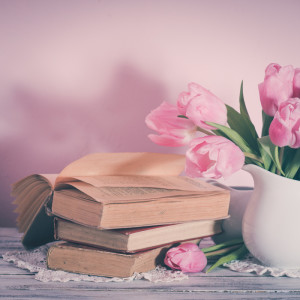 Poem still life with books and pink tulips